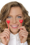 Young woman keeps hearts under the eyes Stock Photos