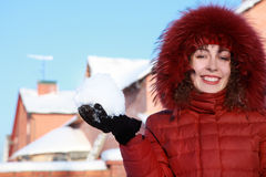 Young woman keeps snow and smiles Stock Image