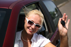 Young woman with keys in the car Stock Images