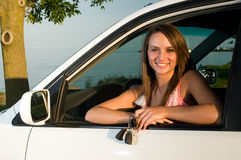 Young woman with keys to auto or car Royalty Free Stock Image