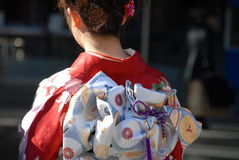 Young woman in kimono. A young Japanese woman in traditional kimono dress Royalty Free Stock Photos