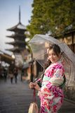 Young woman in kimono clear umbrella. Young woman in kimono holding umbrella front of yasaka pagoda Royalty Free Stock Photography