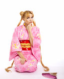 Young woman in kimono cosplay costume Stock Images