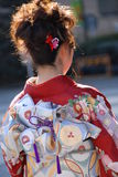 Young woman in kimono dress. A young Japanese woman in traditional kimono on Coming of Age Day in Tokyo Royalty Free Stock Images
