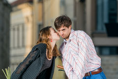 Young woman kisses her boyfriend Stock Images