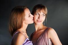 Young woman kissing Stock Photos