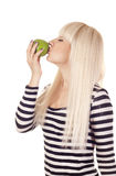 Young woman kissing apple Royalty Free Stock Images