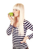 Young woman kissing apple Stock Photo
