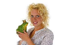 Young woman kissing a frog prince Royalty Free Stock Photo