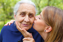 Young woman kissing her beautiful grandma Stock Photos