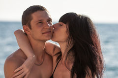 Young woman kissing her boyfriend Royalty Free Stock Photos
