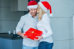Young woman kissing her husband at Christmas Royalty Free Stock Photos