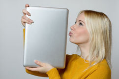 Young Woman Kissing her Laptop Computer Royalty Free Stock Photos