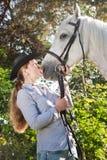 Young woman kissing a horse Stock Photos