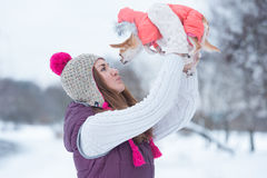 Young woman kissing little dog outdoors Royalty Free Stock Image