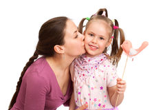 Young woman is kissing little girl Stock Photo