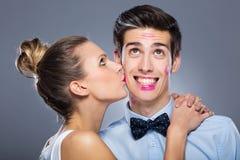 Young woman kissing man Royalty Free Stock Photos