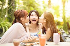 Young woman kissing in restaurant Royalty Free Stock Photo