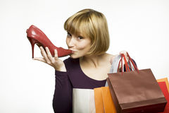 Young woman kissing shoe Royalty Free Stock Photography