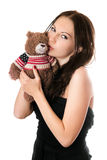 Young woman kissing teddy-bear stock images