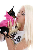 Young woman kissing toy-terrier over white Stock Image