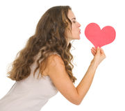 Young woman kissing valentines day cards Royalty Free Stock Photography