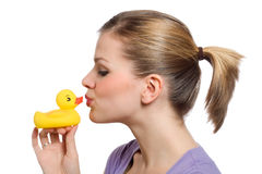 Young woman kissing the yellow rubber duck Stock Images