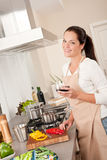 Young woman in the kitchen Stock Image
