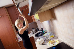 Young woman on kitchen Royalty Free Stock Photos