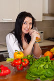 Young woman in kitchen Royalty Free Stock Images