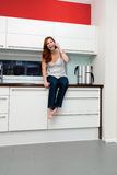 Young woman in the kitchen royalty free stock image