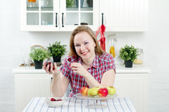 Young woman in kitchen. Young woman with fruit in kitchen Royalty Free Stock Photography