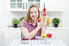 Young woman in kitchen. Young woman with fruit in kitchen Stock Image