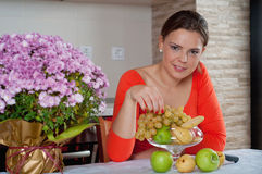 Young woman in kitchen Stock Photography