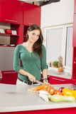 Young woman in the kitchen Royalty Free Stock Images