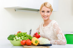 Young woman in the kitchen Stock Photography