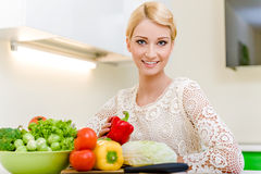 Young woman in the kitchen Royalty Free Stock Photos