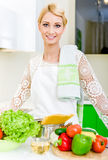 Young woman in the kitchen Royalty Free Stock Photography