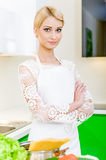 Young woman in the kitchen Royalty Free Stock Photo