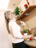 Young woman in the kitchen Stock Images