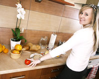 Young woman in the kitchen Stock Photo