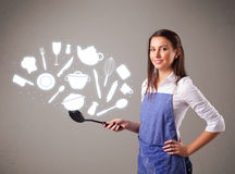 Young woman with kitchen accessories icons. Pretty young lady with kitchen accessories icons Royalty Free Stock Photo