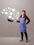 Young woman with kitchen accessories icons Stock Photography