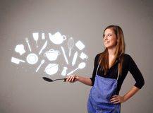 Young woman with kitchen accessories icons Stock Images