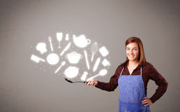 Young woman with kitchen accessories icons Royalty Free Stock Photos