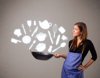 Young woman with kitchen accessories icons Royalty Free Stock Image