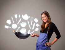 Young woman with kitchen accessories icons Stock Photo