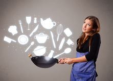 Young woman with kitchen accessories icons Stock Photos