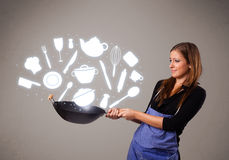 Young woman with kitchen accessories icons Stock Image