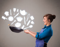 Young woman with kitchen accessories icons Royalty Free Stock Photography